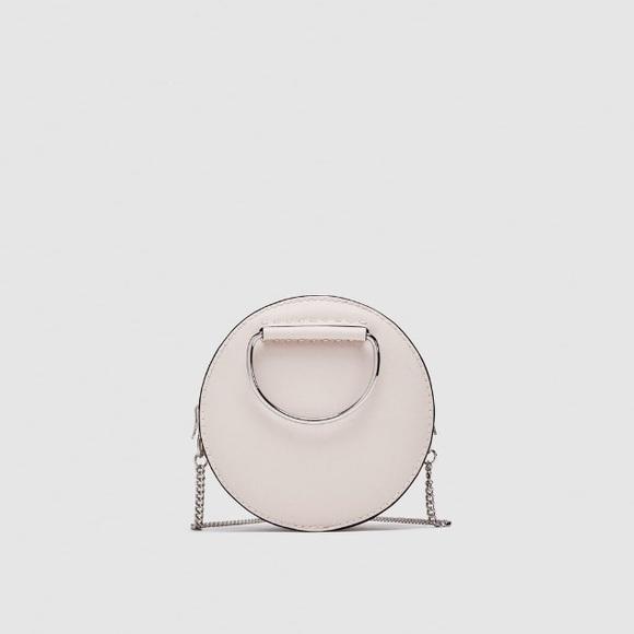 Zara Handbags - Zara ecru oval mini crossbody bag